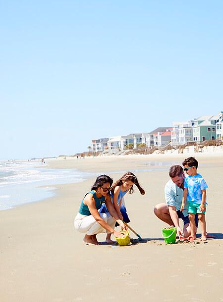 Family on the beach in Pawleys Island, SC