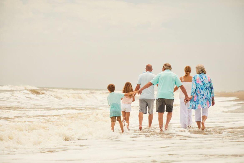 Family walking on the beach in Pawleys Island, SC